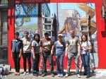 Yale alumni posing in front of mural project for Yale Day of Service in SF Chinatown, May 11, 2013