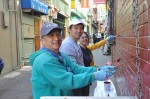 Yale alumni painting over graffiti at a SF Chinatown alley for Yale Day of Service, May 11, 2013